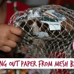 Taking paper out of the mesh bag
