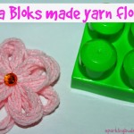 Make yarn flowers using building blocks